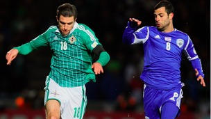 Northern Ireland's Aaron Hughes (left) battles with Israel's Eden Ben Basat.