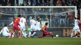 Montenegro's Dejan Damjanovic (centre right) levels during the Group H match in Podgorica