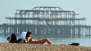 Sunbathers on Brighton beach in March 2012