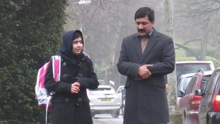 Malala Yousufzai and her father Ziauddin on her first day of school in the UK