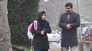 Malala with her father Ziauddin on her first day of school in the UK