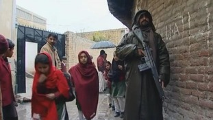 Schoolgirls in Pakistan's Swat Valley go to school under armed guard
