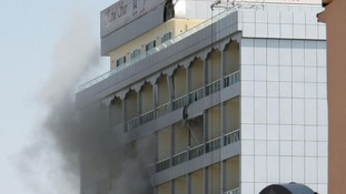 Smoke rises from a hotel after it was hit by a rocket-propelled grenade in Kabul