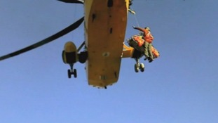 The Sea King winches one of the Search and Rescue crew