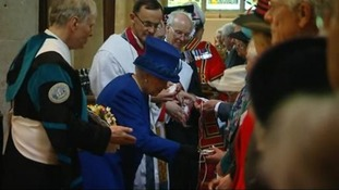 The Queen hands out Maundy money to 87 men and women