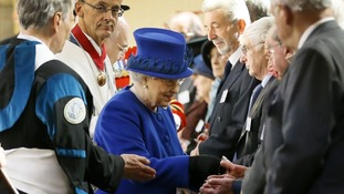 The Queen hands out Maundy money at the Christ Church Cathedral, Oxford.
