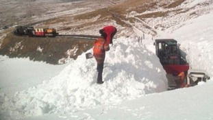 Workers clearing snow from the Snowdonia Railway