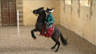 A rider performs dressage at Bolsover Castle