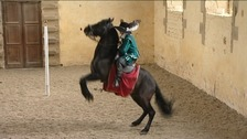 A rider performs dressage at Bolsover Castle