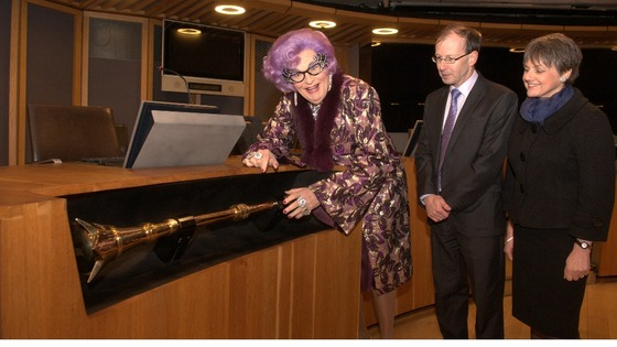 Dame Edna with the Senedd's mace