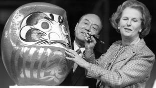 Former Prime Minister Margaret Thatcher seen in 1986 with the Daruma doll