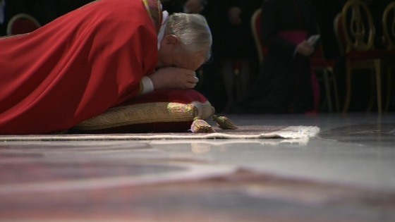 Pope Francis lies prostrate before the alter in St Peter's Basilica