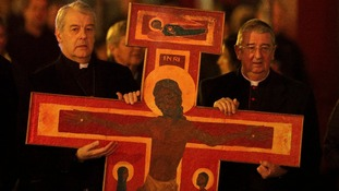 Church of Ireland Archbishop Michael Jackson and Catholic Archbishop Diarmuid Martin jointly carry a cross