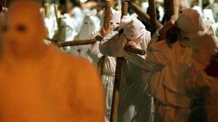 Penitents take part in a Good Friday procession in Civitavecchia, north of Rome