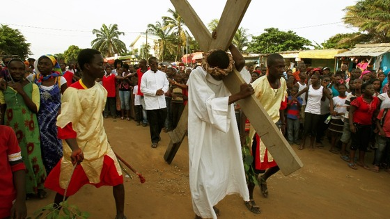 "An actor portraying Jesus Christ takes part in a ""Via Crucis"" (Way of the Cross) at Plateau Dokui, an area of Abidjan"