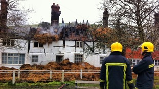 Thatched cottages in East Meon with rooves destroyed by fire