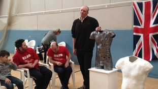 Paralmypian swimmer Darren Leach with the bronze casting of his torso