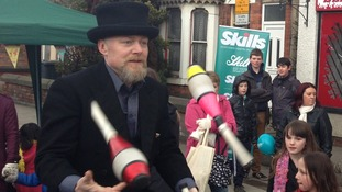 A juggler entertaining children on Chilwell Road in Beeston