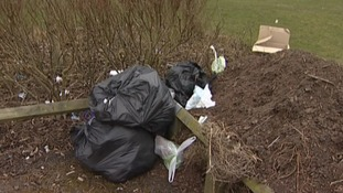 Bags of rubbish have been left scattered across the playing fields and hedgerows