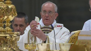 Pope Francis presides at a solemn Easter vigil mass.