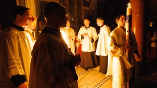 The Paschal candle is carried during the mass.