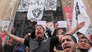 Anti-Mursi demonstrators hear the high court in Cairo this morning