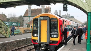 A diesel train at Corfe Castle station