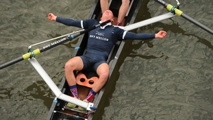 Oxford University's Isis stroke Tom Watson celebrates after his team win the 2013 boat race