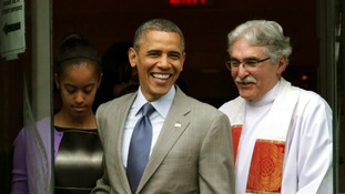U.S. President Barack Obama  and his daughter Malia walk out with Rev. Luis Leon