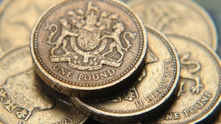 A pile of one pound coins