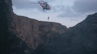 Helicopter winching person