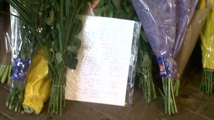 Floral tributes have been left for Ryan Harrison at Guildford Train Station.