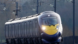 Train passes through Ashford, Kent, using the HS1 Channel Tunnel Rail Link. The routes of HS2 have been unveiled.