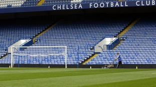 Ground staff attend to the pitch at Stamford Bridge football stadium, London.