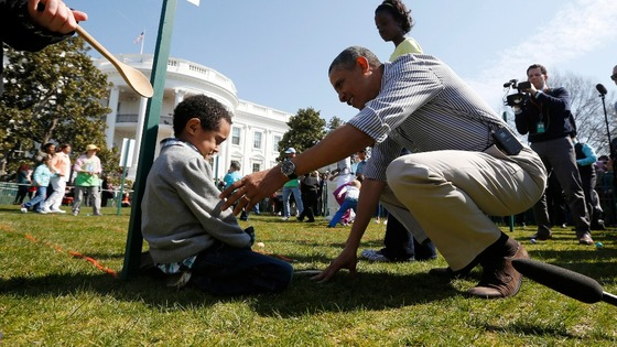 President Obama consoles Donovan Frazier, 5, who lost during his easter egg roll event on the South Lawn of the White House