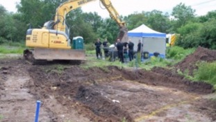 Police excavate a fire pit in Orleton in July 2012