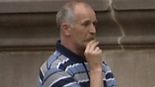 Paul Mosley pictured having a cigarette outside one of the early court hearings