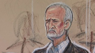 Mick Philpott appearing in the dock at his trial