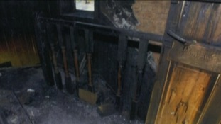 Fire damage on the upstairs landing of the Philpott home