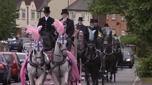 Horse drawn carriages carried each of the children's coffins to church