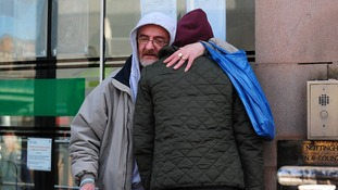 Jimmy Duffy, the father of Mairead Philpott, hugs a family friend outside Nottingham Crown Court.