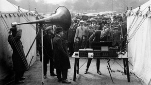 Broadcasting the news during the General Strike of 1926, at a government centre for the maintenance of essential services