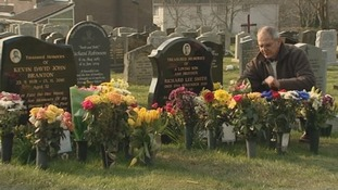 Brian Smith leaves flowers on the grave of his son
