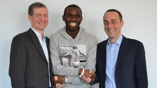 Fabrice Muamba shakes hands with the doctors that saved his life