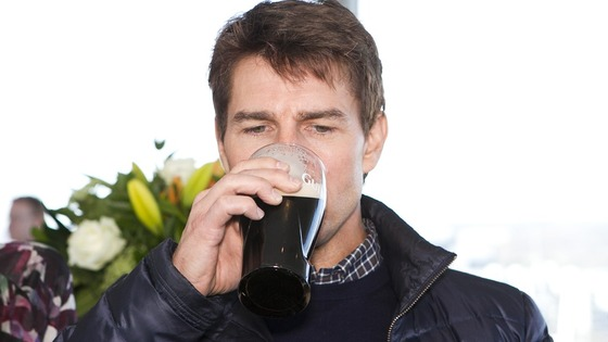 Tom Cruise enjoys a pint of Guinness