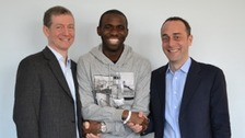 Muamba up and shaking hands