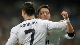 Real Madrid's Cristiano Ronaldo celebrates with Mesut Ozil during the Champions League match at the Bernabeu