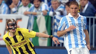 Dortmund's Marcel Schmelzer and Malaga's Joaquin vie for the ball