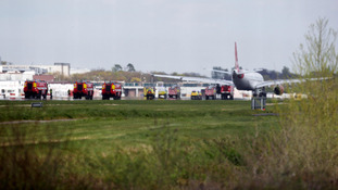 A Virgin Atlantic Airbus A330 aircraft is towed away at Gatwick Airport