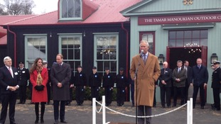 The Prince of Wales is watched by the Duke and Duchess of Cambridge in Dumfries in Scotland.